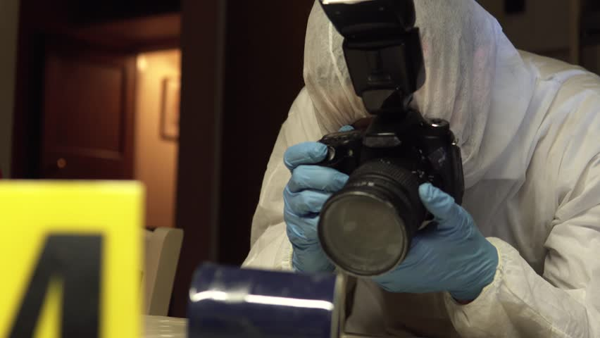 CSI Police Photographer With Camera, Murder Investigation Photographs at Night. Crime Scene Site With Variety Of Angles. Professional Looking For Evidence And Clues.