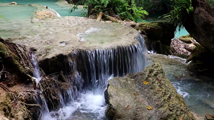 Water cascade in tropical jungle. The Kuang Si Falls, known as Tat Kuang Si Waterfalls Luangprabang, Laos.
