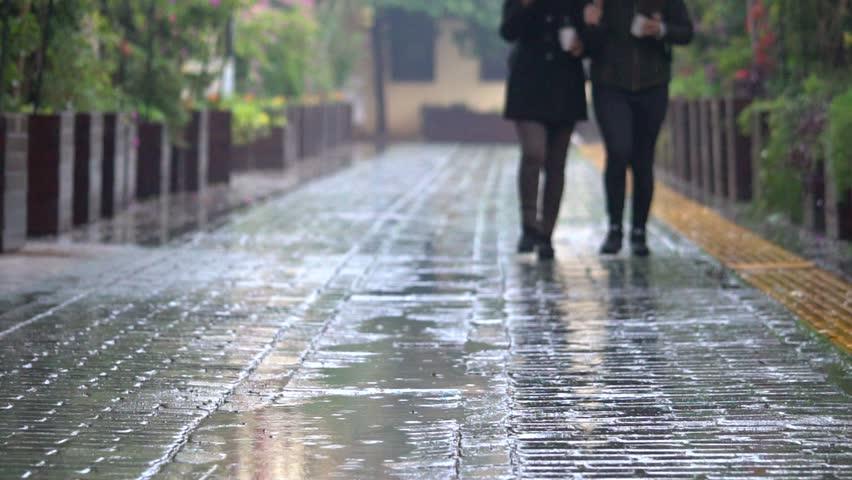 People walking on rainy cobbles european well illuminated street. City life. | Shutterstock HD Video #34855873
