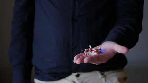 little drone hovering above hand, slow motion