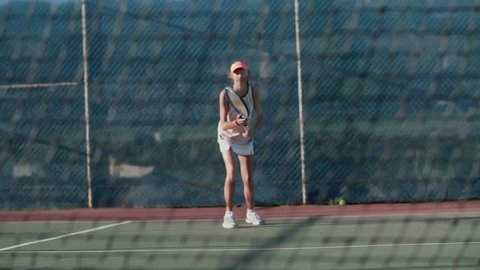 Young sportswoman playing tennis, driven ambitious determined competitive spirit