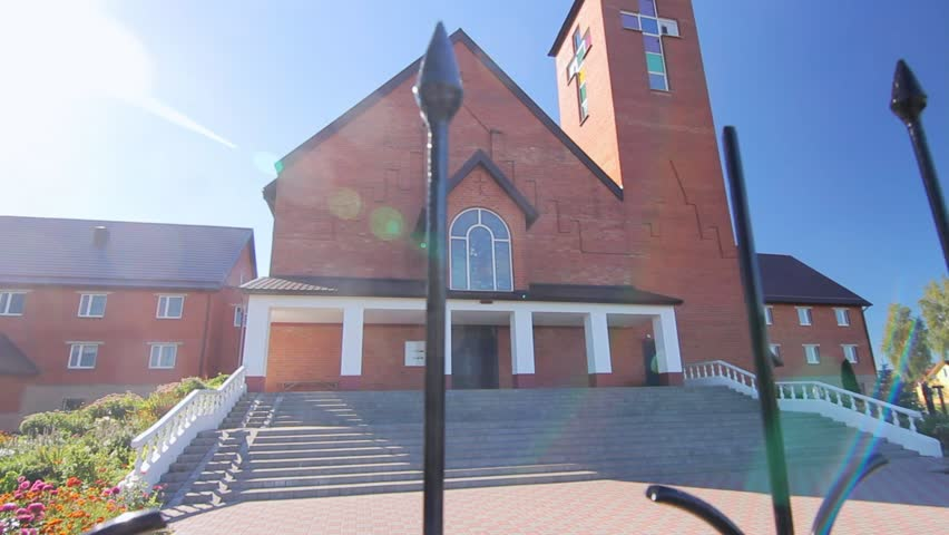 Catholic church building exterior. House of Saints. Entrance to church. Catolic church background