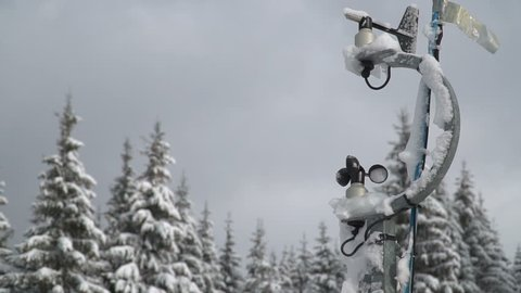 Hydro meteorological center. Wind speed meter anemometer installed in the mountains. Meteorological equipment against the background of trees in the snow in winter