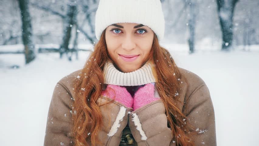 Footage beautiful happy smiling woman at cold and snowy winter walking at New York park. Central Park in New York is one of the largest in the US   Shutterstock HD Video #34944760