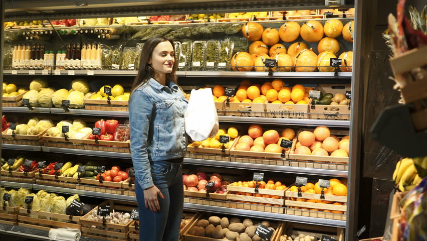 Woman buys fruit and vegetables in the supermarket department. Healthy lifestyle. Vegetarianism. Proper nutrition. | Shutterstock HD Video #34968190