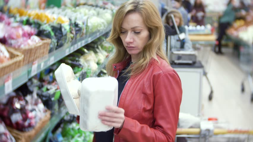 Young woman choosing food in grocery store, woman shopping in supermarket. 4k, background blur | Shutterstock HD Video #34998715