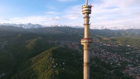 Almaty - MAY 2017: Aerial view shot of the Koktobe TV tower and mountains on background