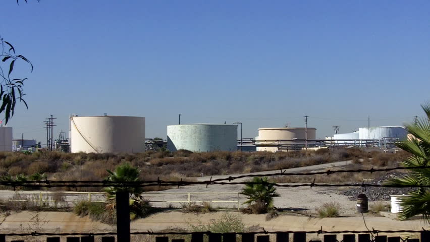 SANTA FE SPRINGS, CA - February 23, 2013: Aging oil storage tanks in an old refinery circa 2013 in Santa Fe Springs.California frequently has higher gas prices due to its aging petroleum refineries.