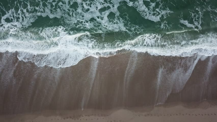 Cinematic Drone Footage of Waves Rolling In
