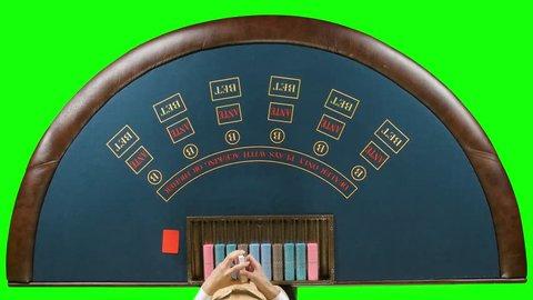 Casino dealer shuffles the cards. Green screen