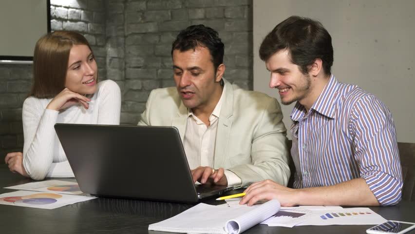 Hispanic mature businessman helping his employees during business meeting | Shutterstock HD Video #35024455