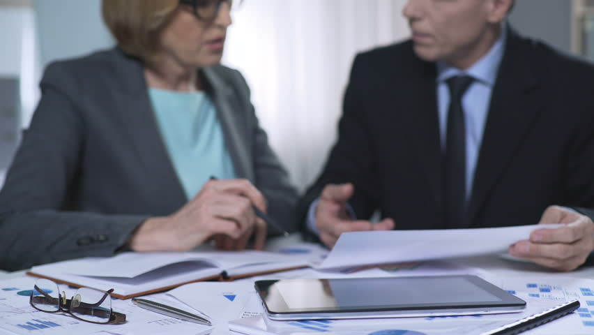 Business meeting of investor and chief of clinic, discussing project financing | Shutterstock HD Video #35027413