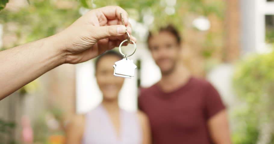 4K Portrait happy couple in front of new home, taking the key from estate agent. Slow motion. | Shutterstock HD Video #35044183