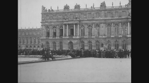 CIRCA - 1919 - Crowds gather at Versailles, France for the signing of the Treaty of Versailles.