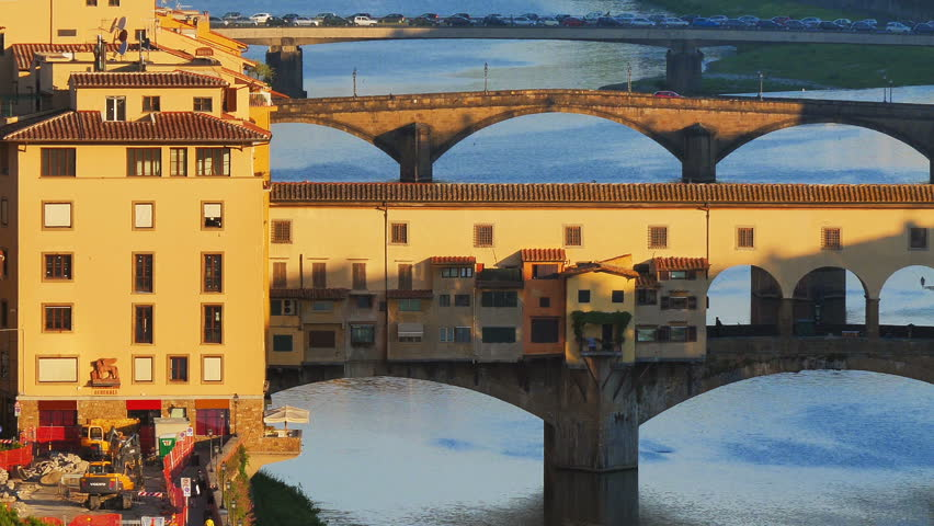 florence attraction ponte vecchio at sunrise seen from distance