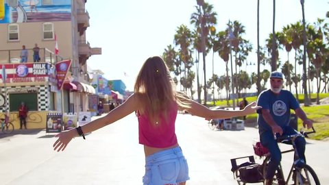 skateboarding women at city. Venice beach. Los Angeles, California, USA