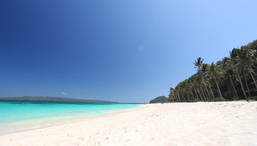 Puka beach, Boracay. Tropical pristine beach with coconut palm and turquoise water, travel destinations