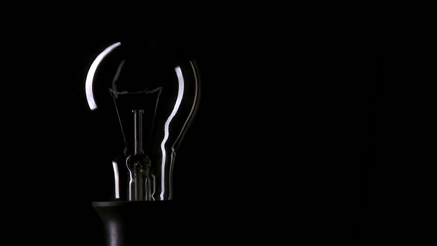 Real light bulb turning on and turning off on black background, copy-space, HD, loopable