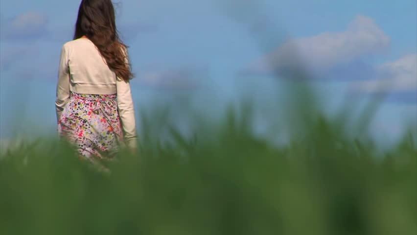 woman walking in grass - photo #13