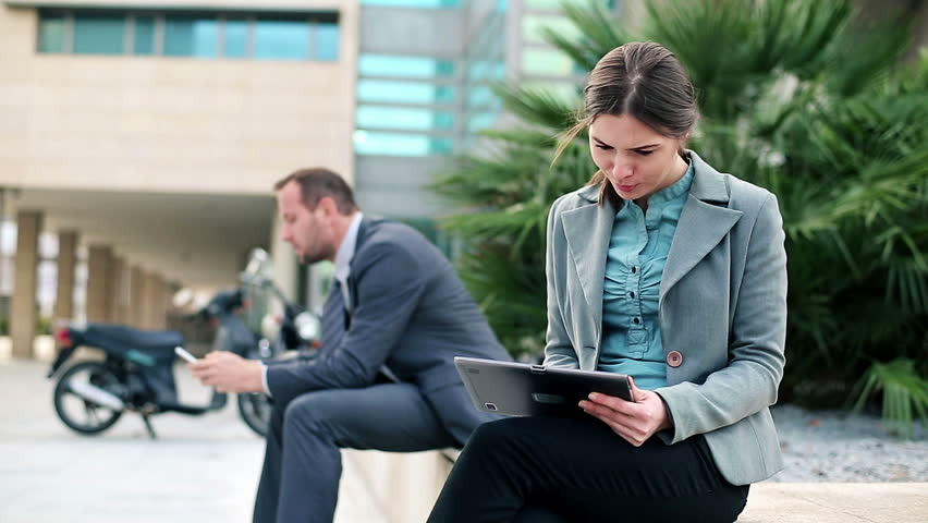 Business people with tablet computer and smartphone in the city