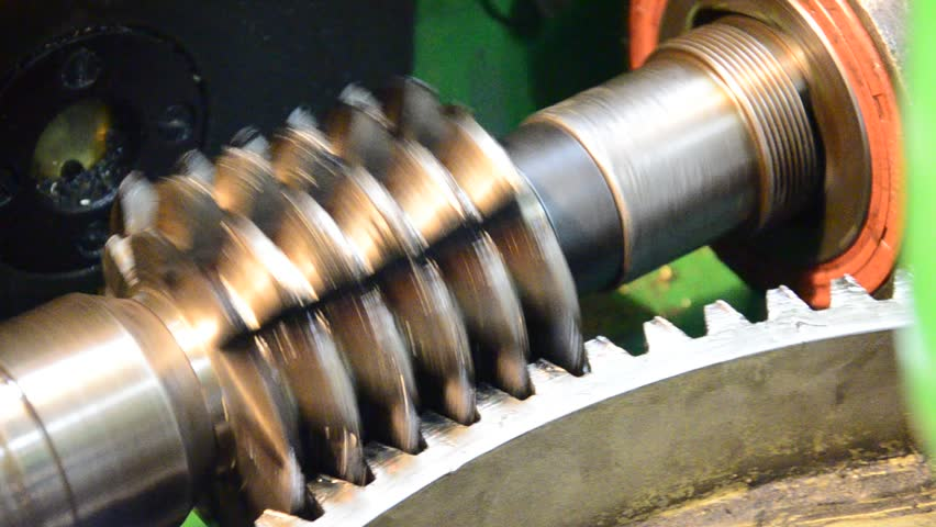 wormwhee gear, cogwheel production and service industrial machine, rotating gears extreme closeup view