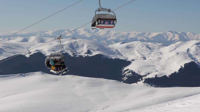 SINAIA, ROMANIA - MARCH 2, 2013 Tourists near Ski Resort in Beautiful Mountains in Cold Winter Landscape | Shutterstock HD Video #3571451