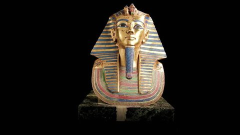 King Tut Sarcophagus rotating over black background - looping video