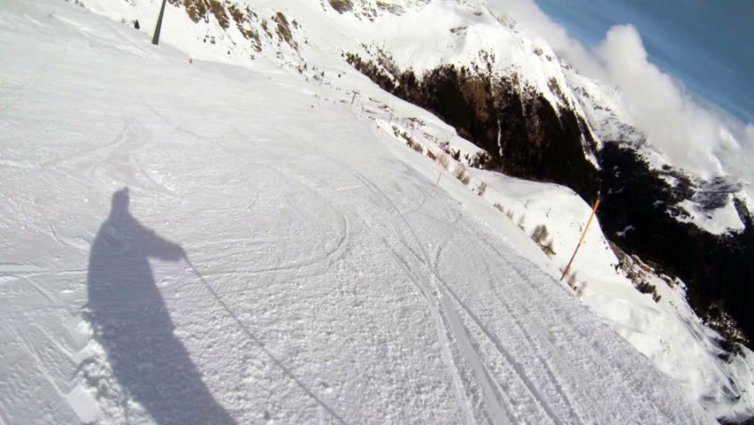 Alpine skiing in italy with the action cam on the helmet, sliding down snow-covered hills. pov.  | Shutterstock HD Video #3573365