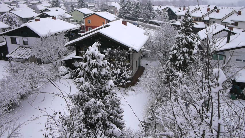 AERIAL: Winter town covered in snow