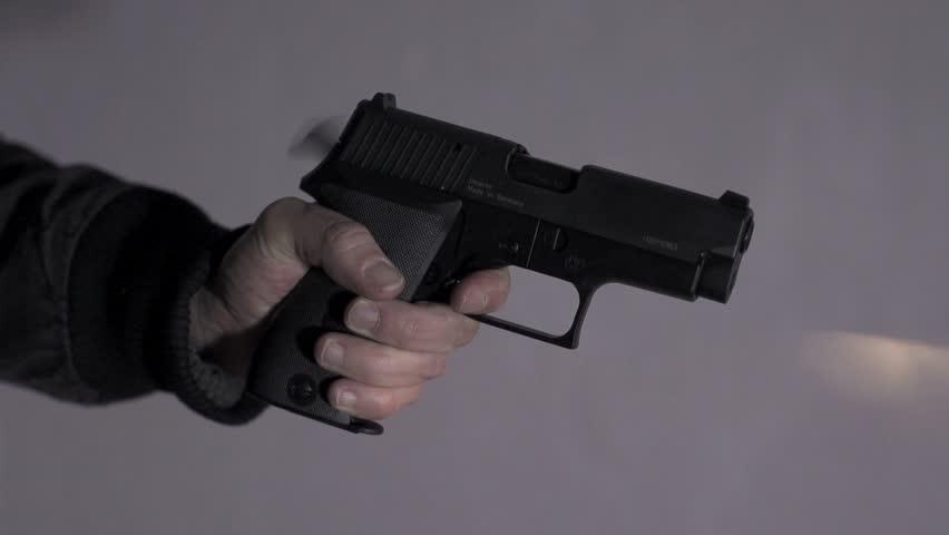 gun shot in slow motion. guns weapon. police officer using gun weapon. undercover. crime criminal. guns.crime scenery