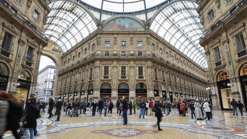 MILAN, ITALY - MARCH 23: (Timelapse View) People Shopping in Vittorio Emanuele II Gallery on March 23, 2013 in Milan. The Gallery is the oldest shopping mall in Italy, built between 1865 and 1877.