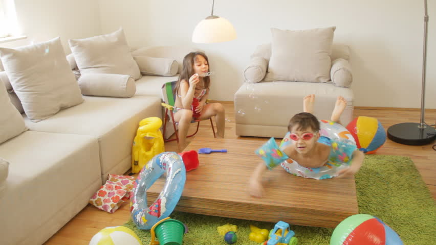 kids living room. Kids Playing In The Living Room  Fantasize About They Are On A Beach Stock Footage Video 3623783 Shutterstock
