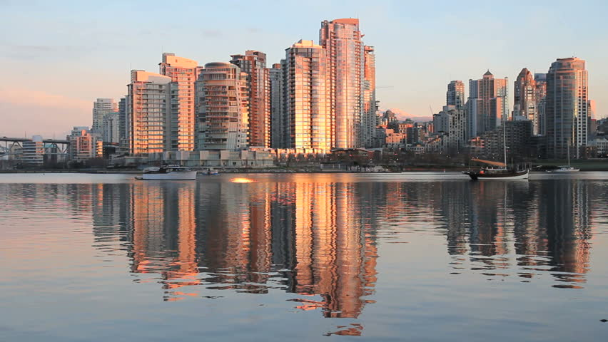 Yaletown, False Creek, Sunrise Reflection. Sunrise reflects off Yaletown condominiums in downtown Vancouver. British Columbia, Canada.