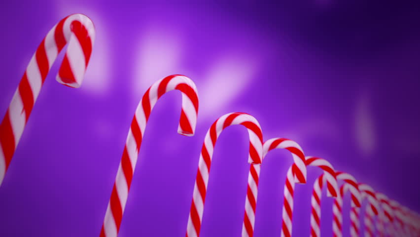 Hard cane-shaped candy sticks with traditional white and red stripes, flavored with peppermint is very popular during Christmas holidays. Animation is loopable.
