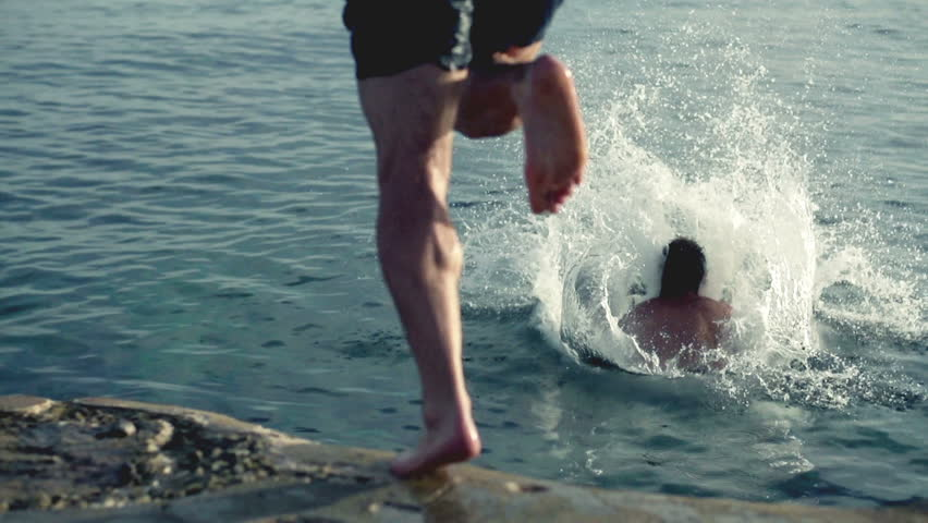 Young three men jumping into the sea, slow motion shot at 120fps  #3646793