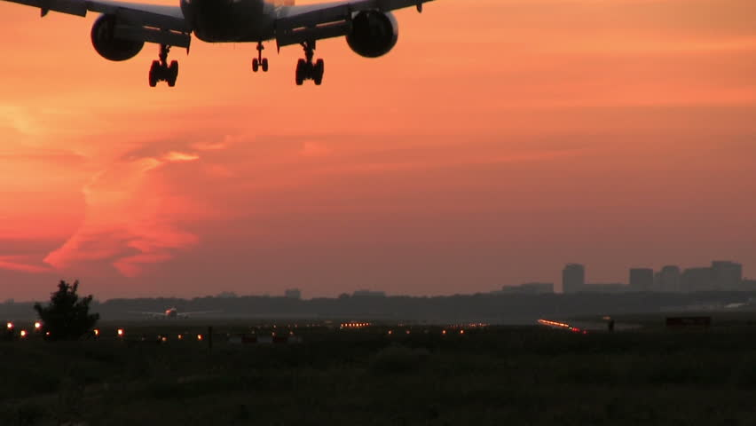 Big plane landing at dusk All Airplane footage has been recorded with the use of a Rode NTG-1 External Microphone