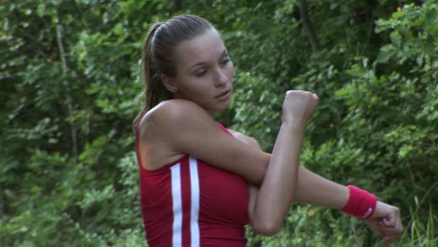 HD1080p Young attractive athletic woman stretching the muscles of her arms.