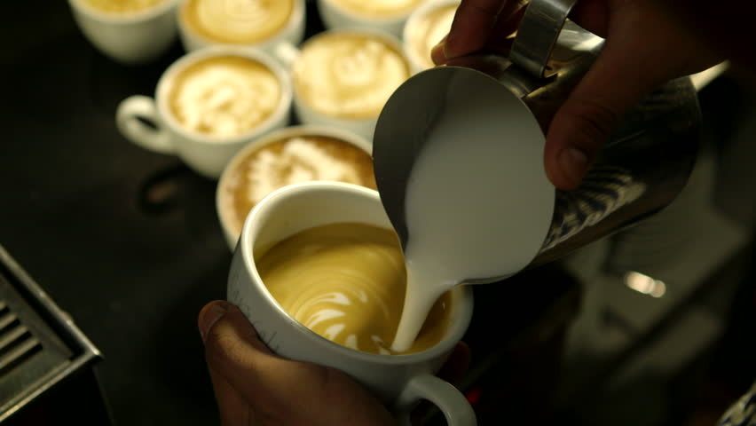 Barista makes pattern in coffee     #3660287