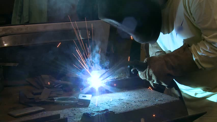 Bright arc of a welder working on a job | Shutterstock HD Video #3662753
