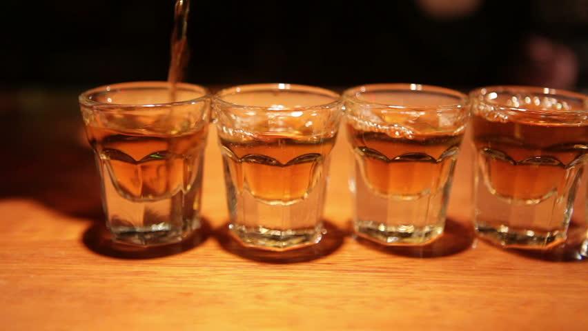 Tracking shot of bourbon shots