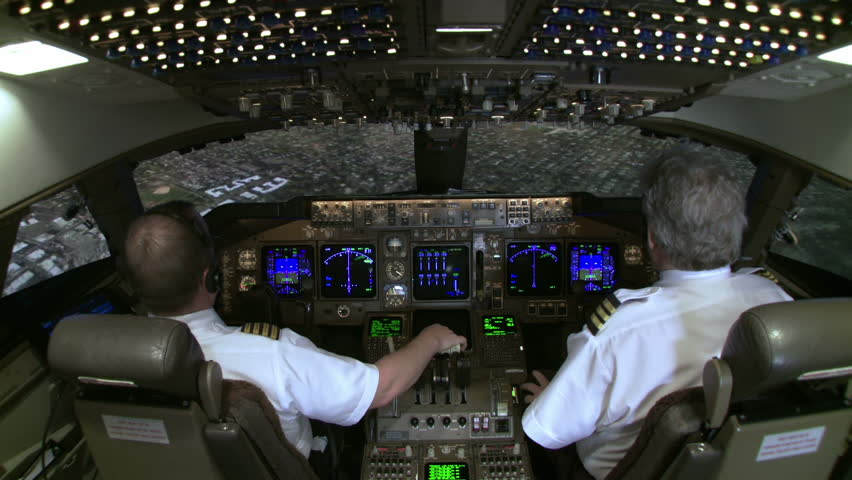 High view of 747 cockpit as pilot brings plane in to final approach over New