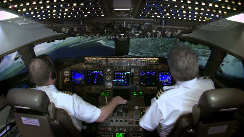 High view of 747 cockpit as pilot brings plane in to land at John F Kennedy