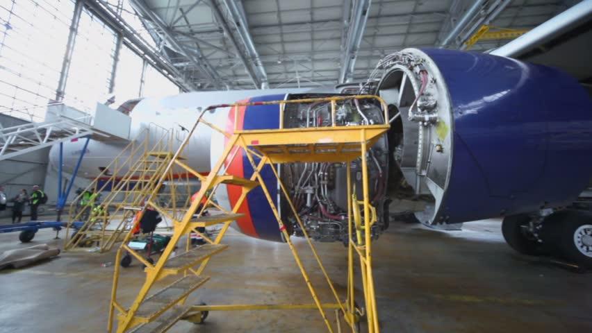 Dismantled turbine of aircraft under repair in hangar