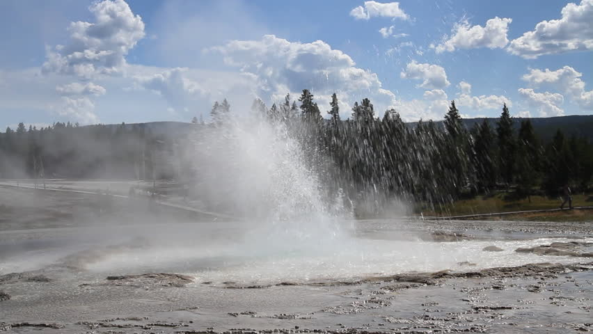 Sawmill Geyser erupting, sending up showers of hot water at Yellowstone Park,