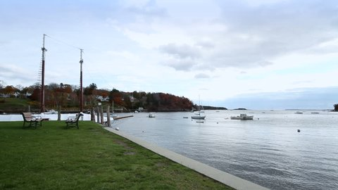 Pan across the bay at the quayside in Rockport, Maine, USA.