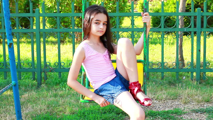 Stock Video Of Sad Young Girl On Swing In  3739013  Shutterstock-4464