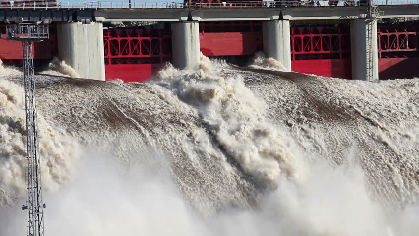 Spring flood water flowing on hydroelectric power station dam | Shutterstock HD Video #3774962
