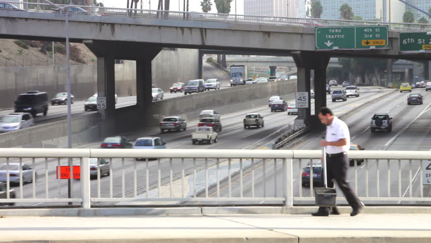 Time lapse view of speeding traffic taken from bridge over freeway. Shot on Canon 5d Mk2 with a frame rate of 30fps | Shutterstock HD Video #3782603