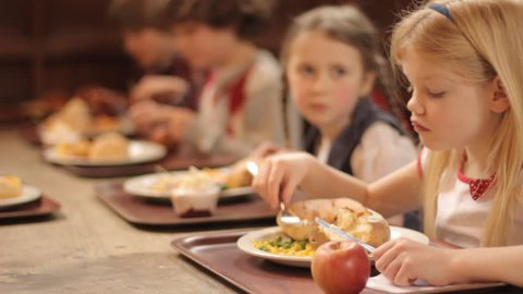 School food - a group of elementary school children eating a school lunch