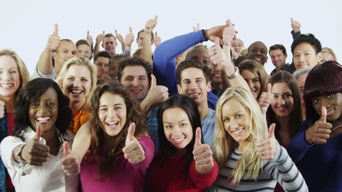 Portrait of a happy and diverse multi ethnic group of people in colorful casual clothing, isolated on white in a studio shot. They all hold their thumbs up to camera as a sign of their success.